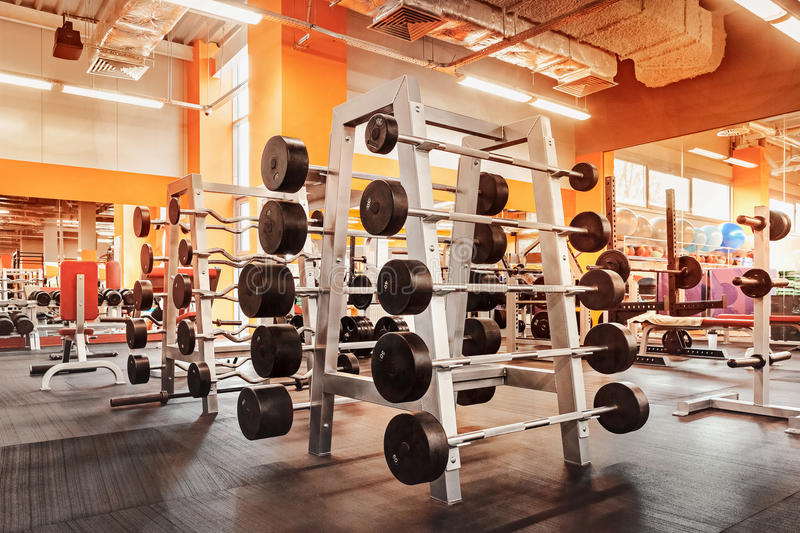 Download Various Dumbbells In Gym A Bright Orange Interior Stock Image - Image: 89635383