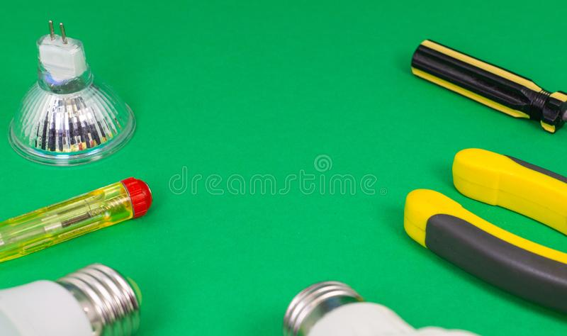 Different electrical tools on light green background royalty free stock photography