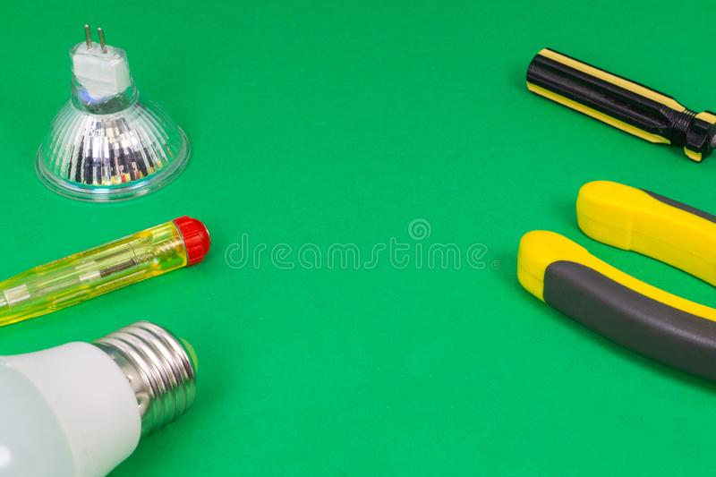 Different electrical tools on light green background stock photography