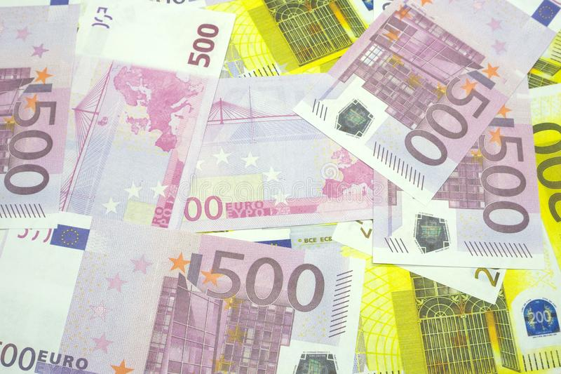 Various Euro banknotes of 200 and 500 Euro banknotes in a continuous layer.  royalty free stock images