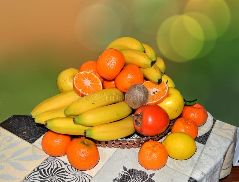 Various exotic fruits set in a basket on a table stock photo