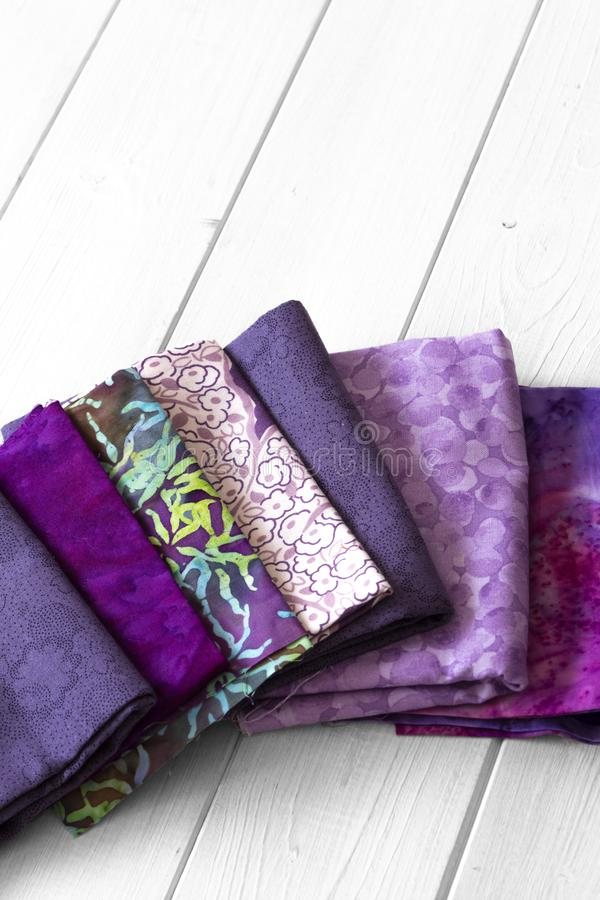 Various fabric material sample swatches,  with a purple theme stock images