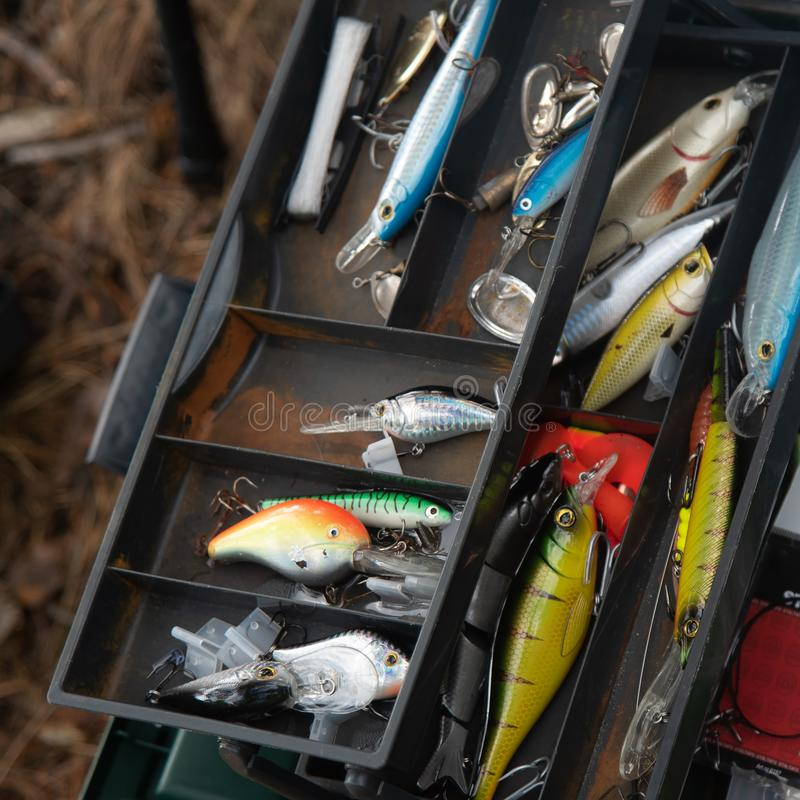 Various fishing lures in the old box stock photography