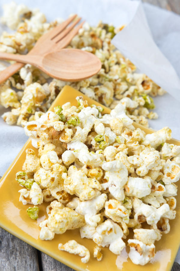 Various flavored popcorn royalty free stock photography
