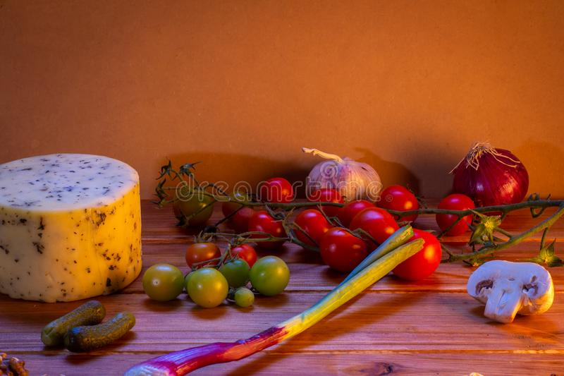 Various foods and other edibles on a rustic background. Fresh food royalty free stock photo