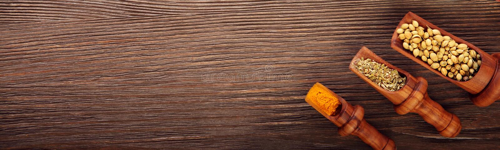 Various fragrant Herbs and Spices over wooden background stock image