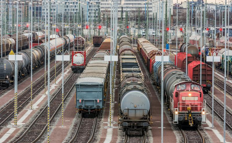 Various freight cars on several tracks. Excerpt of a freight yard with eight adjacent tracks, different wagons and a locomotive stock images