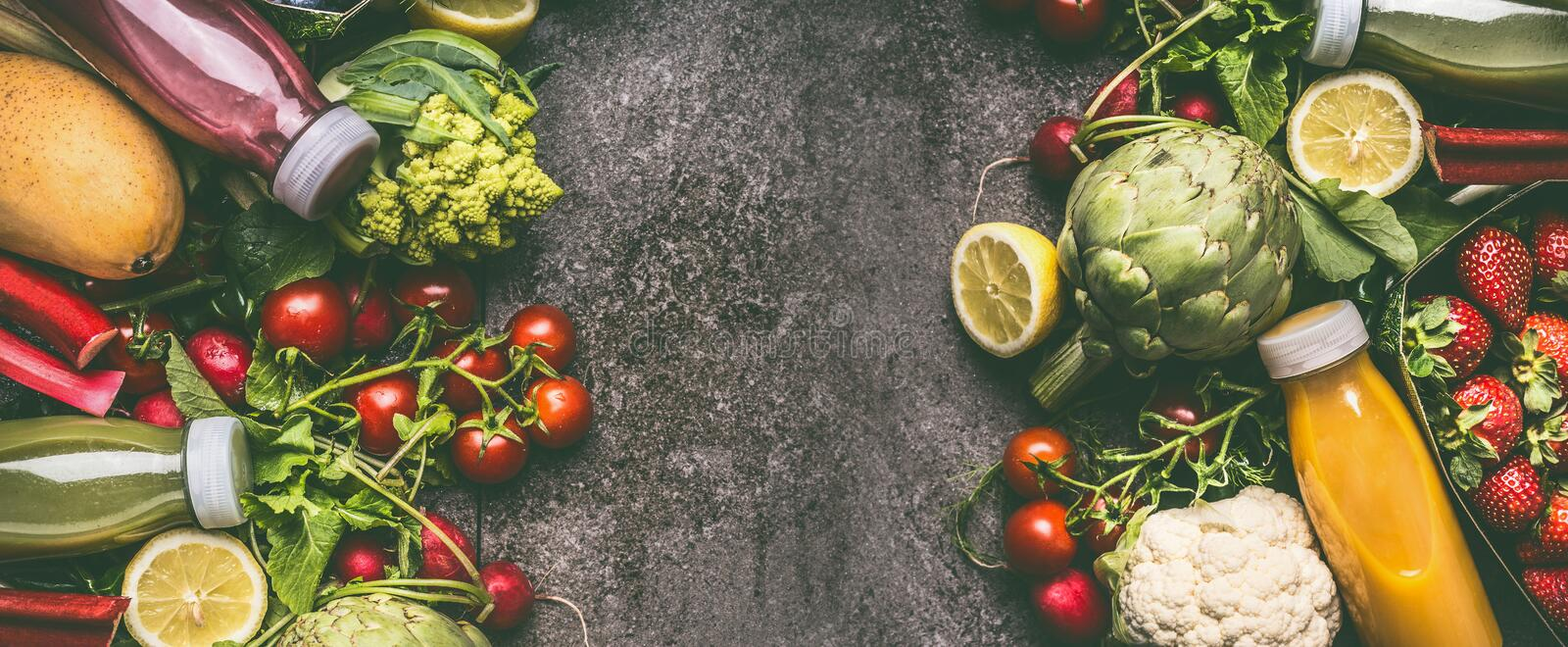 Various fresh colorful organic vegetables, fruits and berries smoothie with ingredients in bottles on gray granite table stock photography