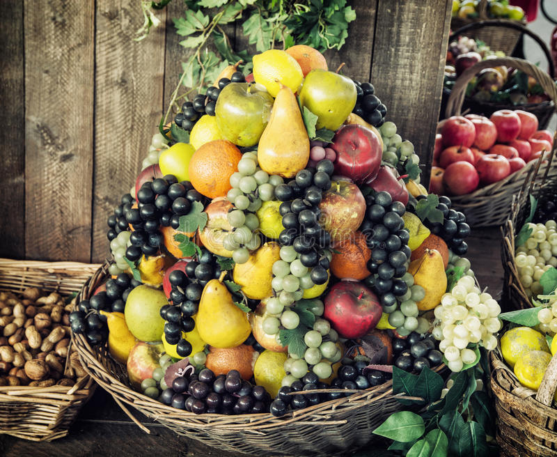 Various fresh fruits in the wicker baskets, healthy food, market. Various fresh fruits in the wicker baskets. Healthy food. Market place. Vitamin bomb stock photo