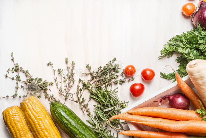 Various fresh organic vegetables on white wooden background, top view. Border stock photos