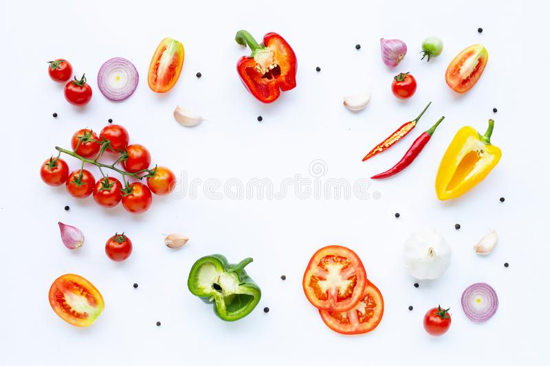 Various fresh vegetables and herbs on white background. Healthy eating concept royalty free stock images