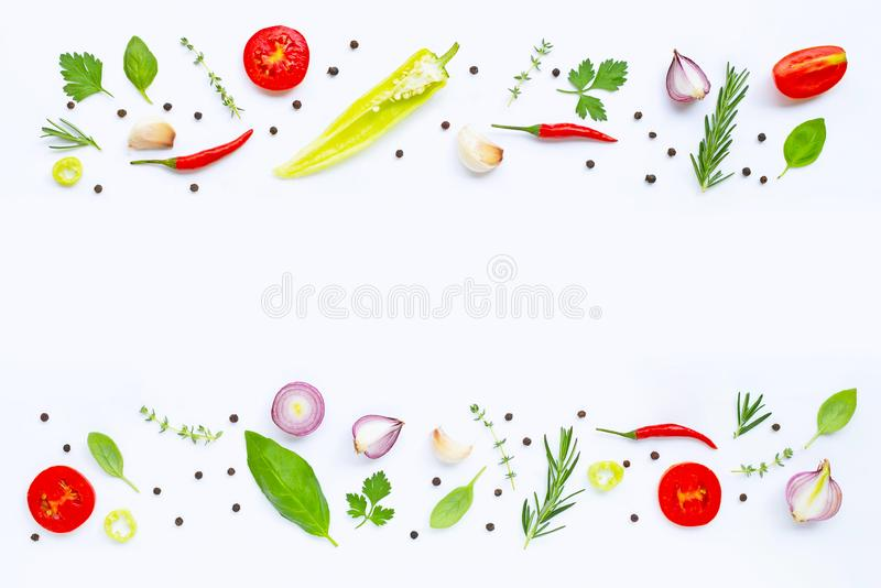 Various fresh vegetables and herbs on white. Healthy eating concept. Various fresh vegetables and herbs on white background with copy space. Healthy eating stock images