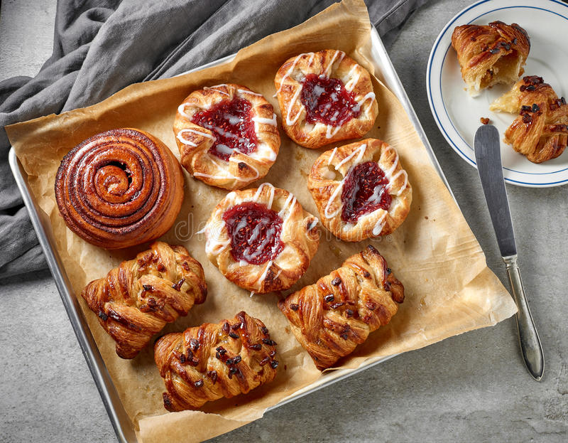 Various freshly baked sweet buns stock photos
