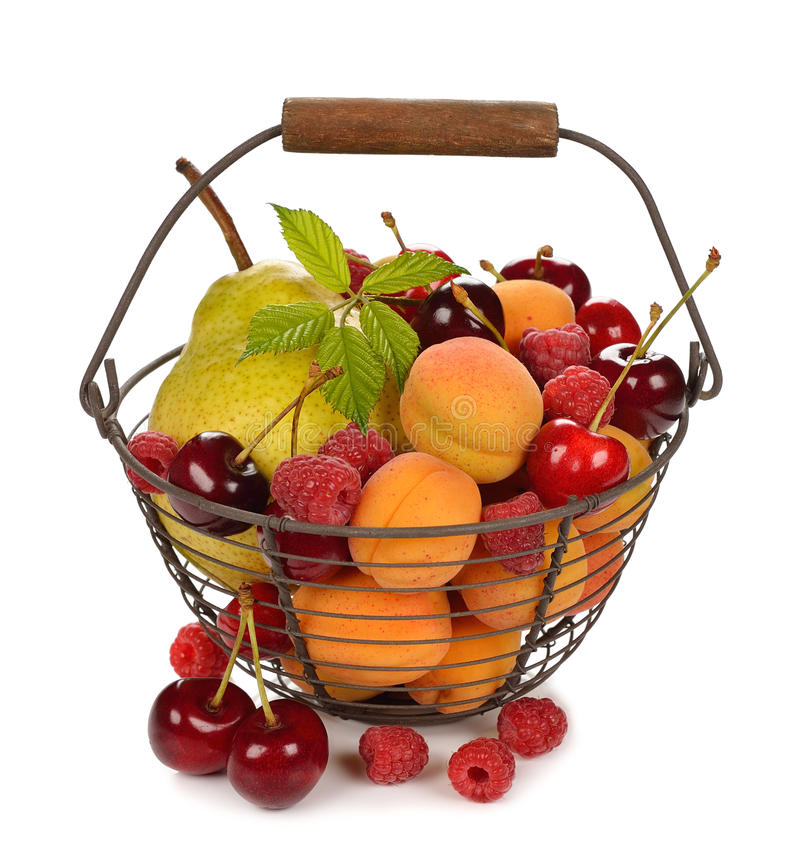 Various fruit in a basket. On white background stock images