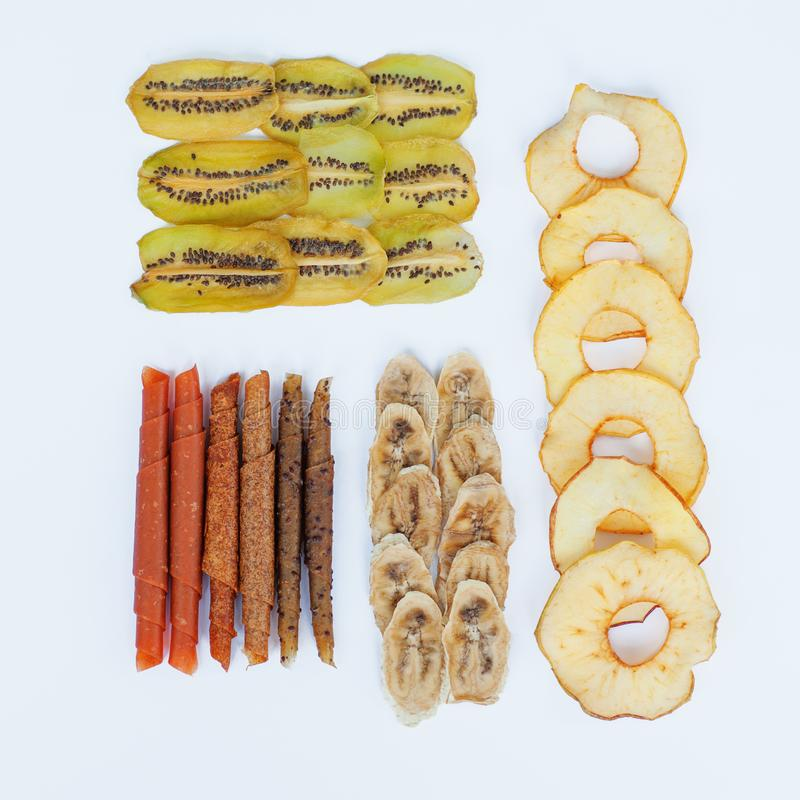 Various fruit chips and pastila on white background. Assorted dehydrated apple, banana, kiwi fruit chips - healthy vegan snack. Health sport concepts. Square royalty free stock image
