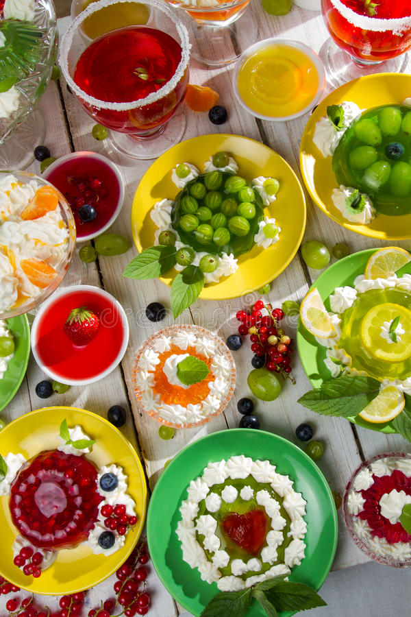 Various fruit jelly with cream royalty free stock image