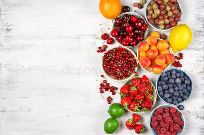 Various fruits in bowls royalty free stock photo