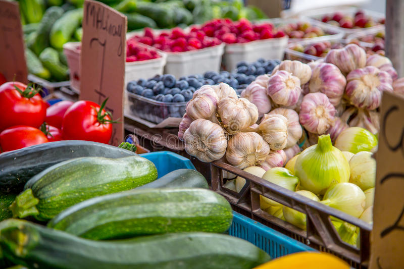 Various fruits and vegetables on the farm market in the city. Fruits and vegetables at a farmers market stock image
