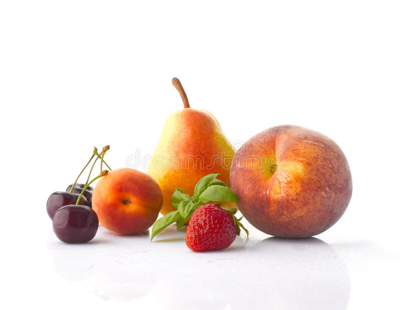 Various fruits on the white background royalty free stock photos