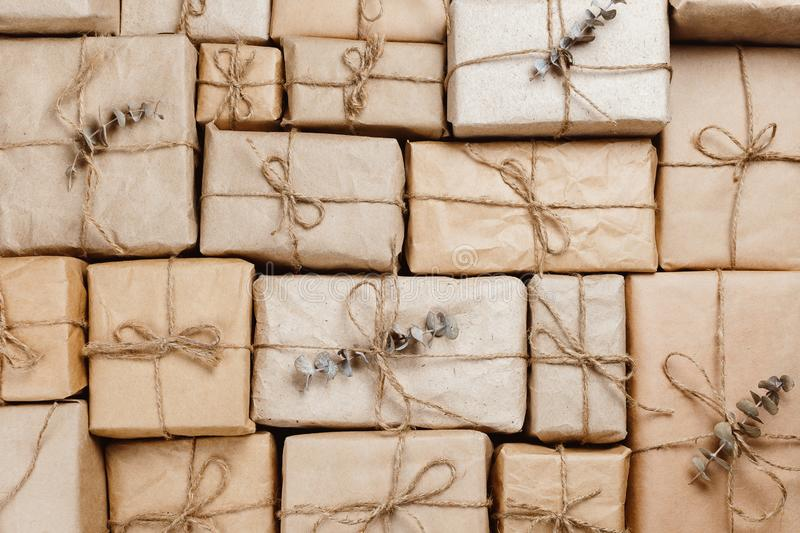 Various gift boxes wrapped in eco-friendly craft paper. With strings royalty free stock photo