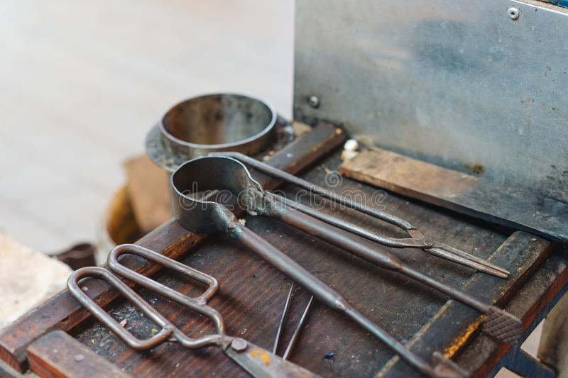 Various Glass Blowing Old Tools, Close View. Various Glass Blowing Old Tools on the Table, Close View stock image