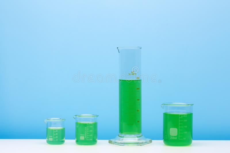 Various glass flasks with a colored liqiuds. Laboratory glassware set stock image