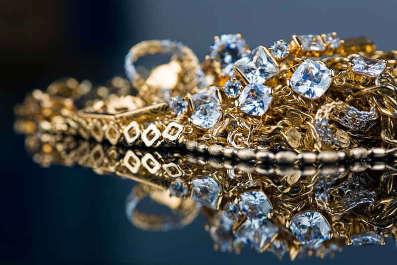 Various Gold Jewellery On Black Background Stock Photo ...