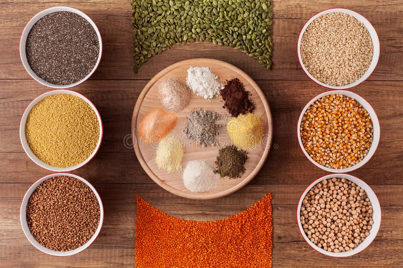 Various grains and their flour - top view stock image