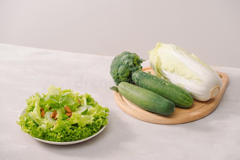 Various green organic salad ingredients on white background. Healthy lifestyle or detox diet food concept stock images