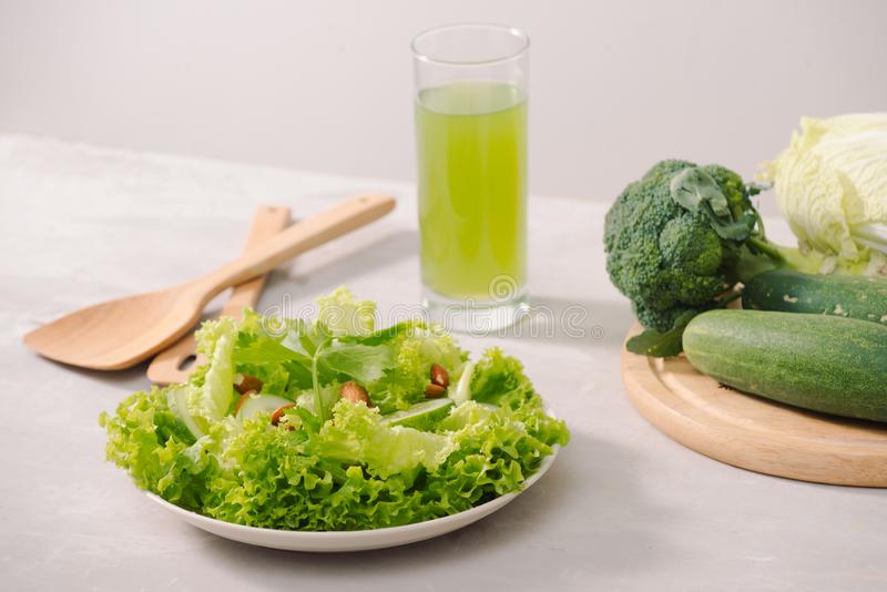 Various green organic salad ingredients on white background. Healthy lifestyle or detox diet food concept stock image