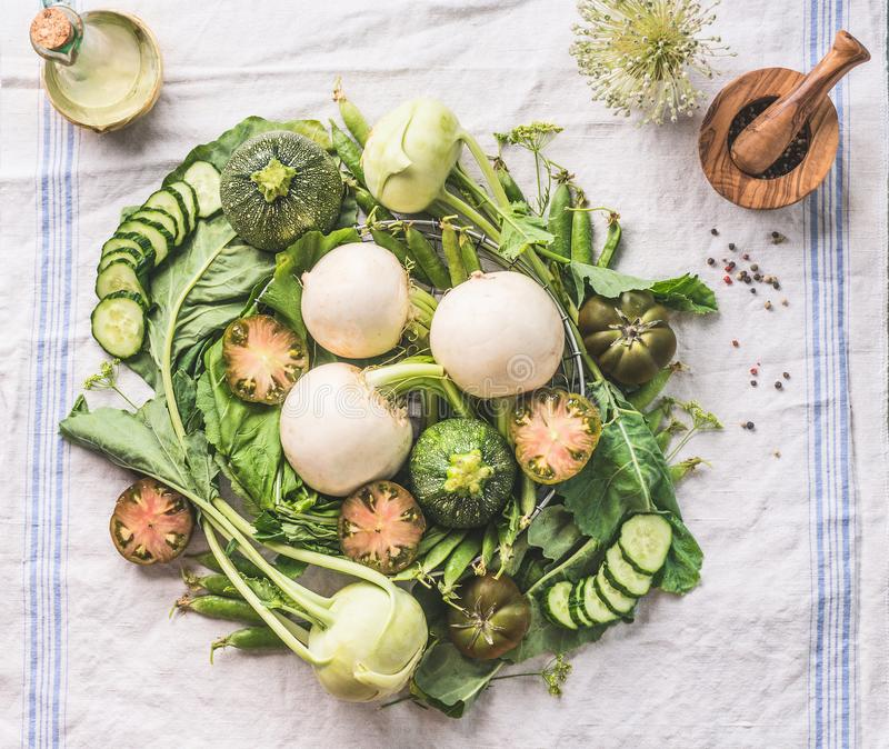 Various green organic seasonal vegetables from local farm market on light kitchen table , top view. Healthy vegetarian eating and. Cooking concept. Clean food stock images