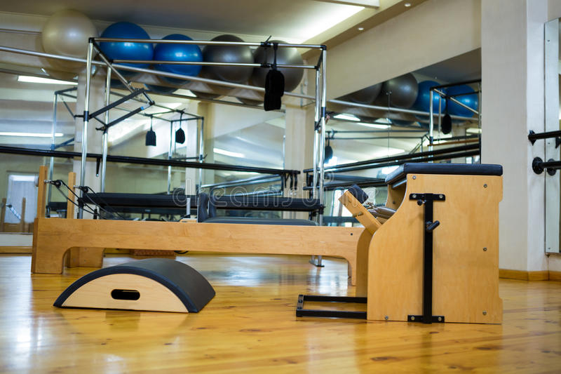 Various gym equipments on wooden floor. In gym stock photography
