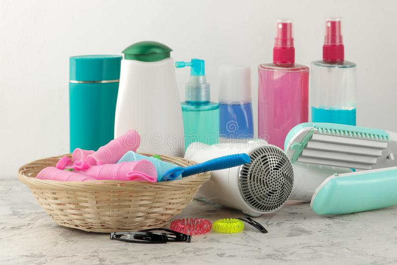 Various hair care products and various hair accessories for combs, elastics, hair curlers, hair dryers. on a light background. hai. R cosmetics stock photos