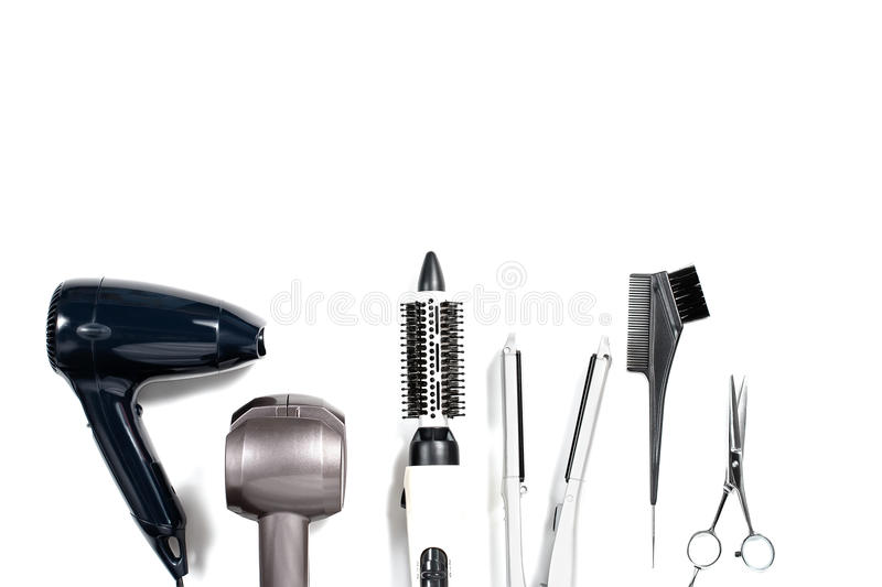Various hair styling devices on white background, top view. Various hair styling tools on white background, top view, copy space royalty free stock photography