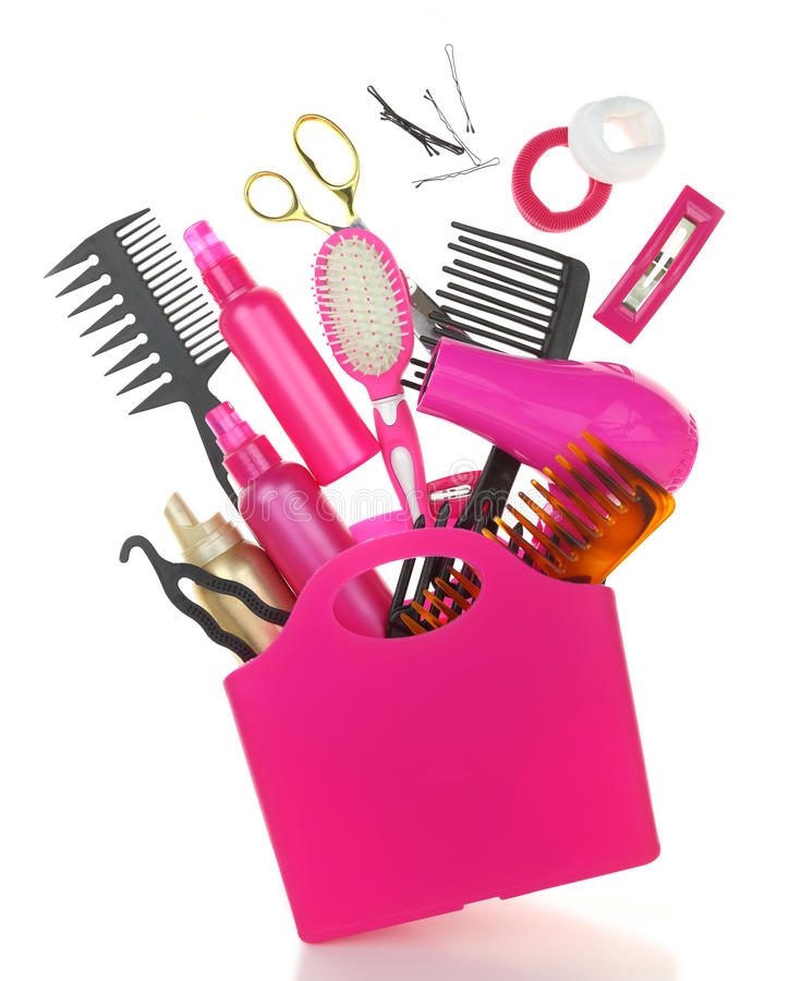 Various hairstyling equipment in shopping bag stock photo