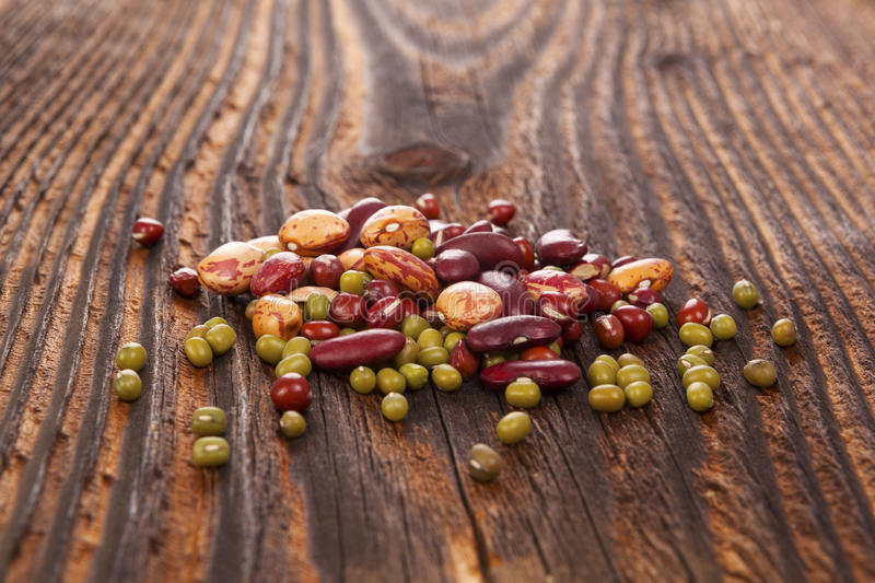 Various healthy legumes. On wooden table. Mungo beans stock photography