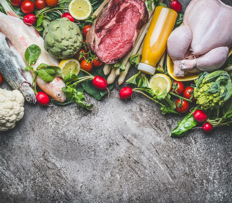 Various healthy organic balanced food ingredients : vegetables, fishes, meat, chicken, juices beverages drinks on gray concrete b. Ackground , top view, border stock photos