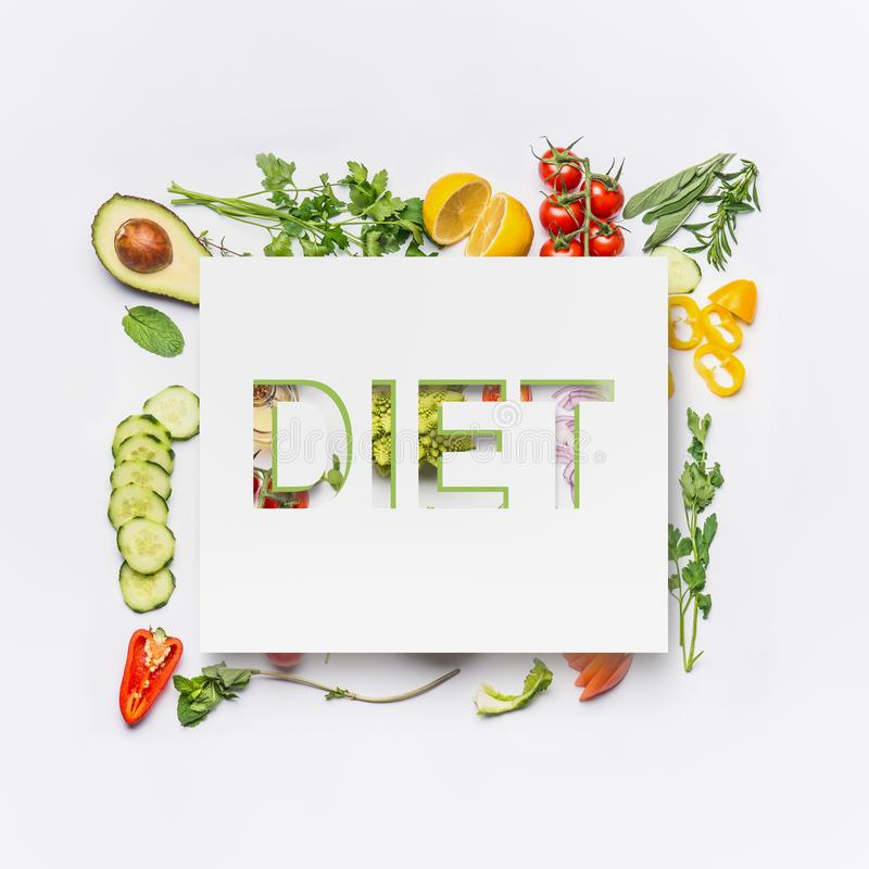 Various healthy salad vegetables ingredients and text diet on white desk background, top view. Clean eating layout. Vegetarian food and diet nutrition concept stock photos