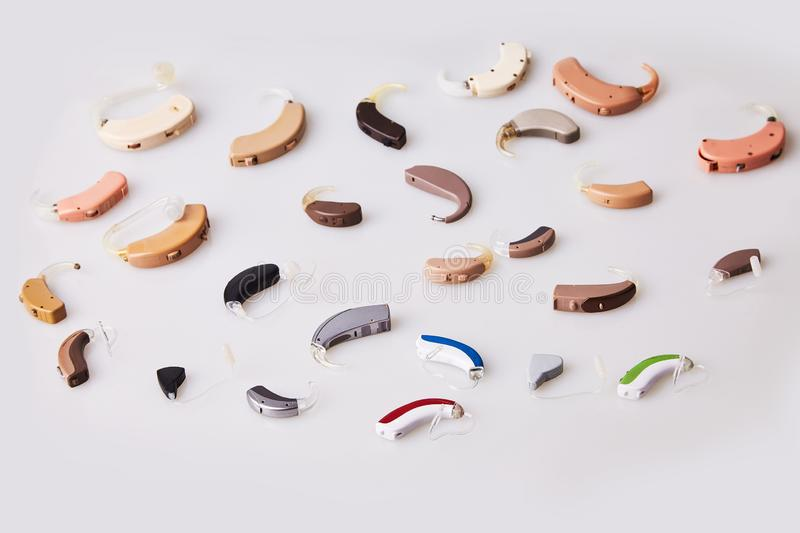 Various hearing aids on white background, alternative to surgery. ENT accessory. stock photo