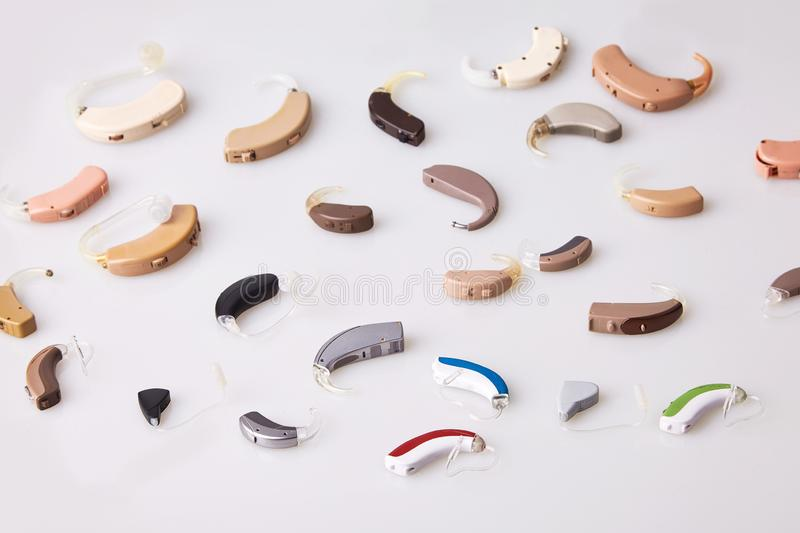 Various hearing aids on white background, alternative to surgery. ENT accessory. Otolaryngologist instrument stock photo