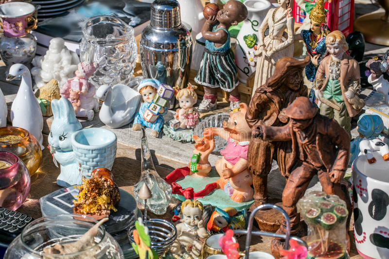 Various household objects at thrift store for over-consumption. Mix of household things and various decoration objects and toys at flea market for second hand stock image