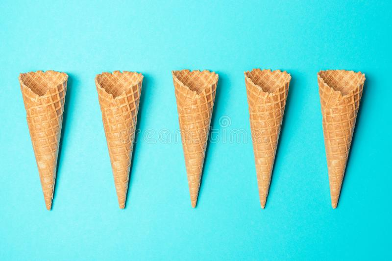 Various ice cream cones on blue background. Minimal summer concept stock photo
