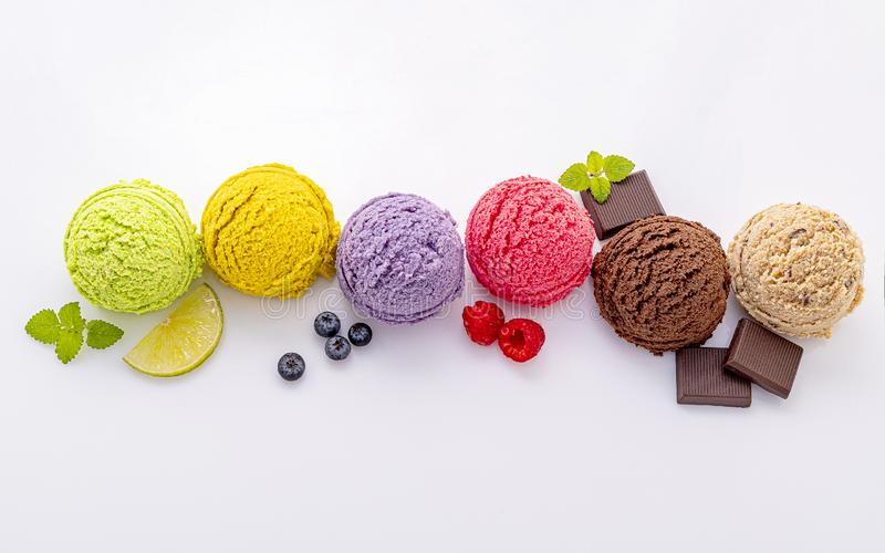 Various of ice cream flavor ball blueberry ,lime ,pistachio ,almond ,orange ,chocolate and vanilla isolate on white background . Summer and Sweet menu concept stock image
