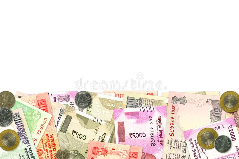 Various indian banknotes and coins illustrating indian economy. Various indian banknotes and coins illustrating growing indian economy and investment with copy royalty free stock photo