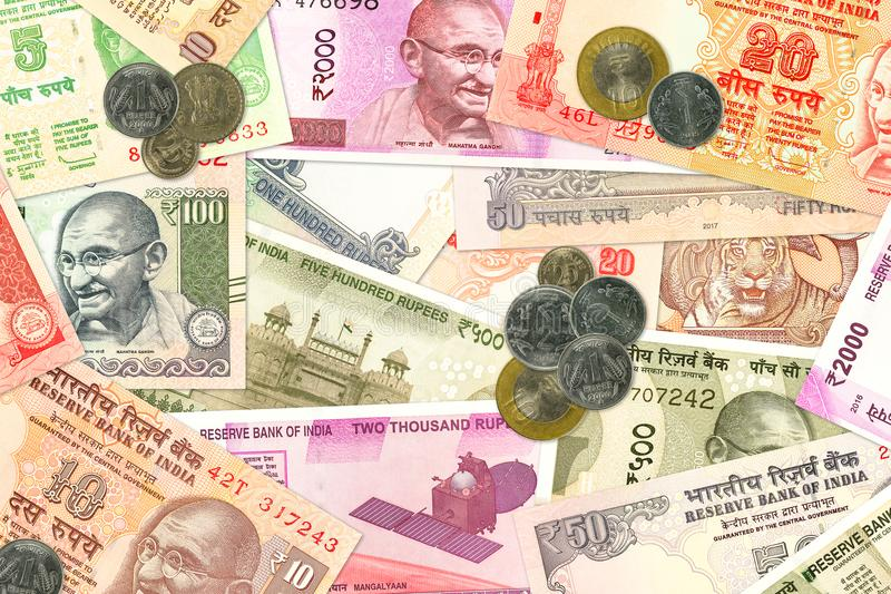 Various indian banknotes and coins illustrating indian economy. Various indian banknotes and coins illustrating growing indian economy and investment stock images