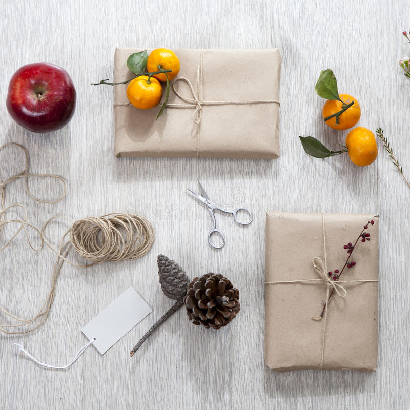 Various items for gift wrapping are on the table. royalty free stock image