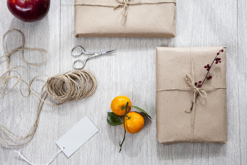 Various items for gift wrapping are on the table. Gifts already packed stock photography