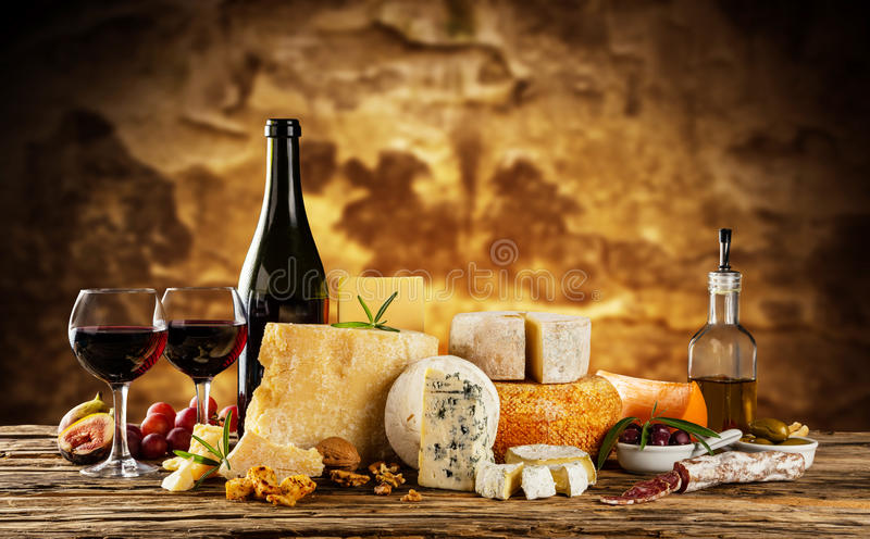 Various kind of cheese served on wood royalty free stock photo