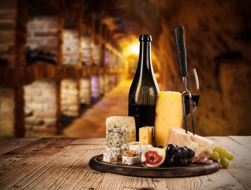 Various kind of cheese with wine royalty free stock images
