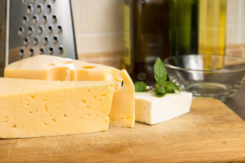 Various kind of cheese on Wooden Board stock photography